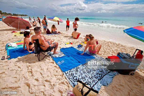 People take part in a picnic as part of a protest in Playa del Carmen Mexico on February 23 2020 Some 1000 people participated in a picnic Sunday in...