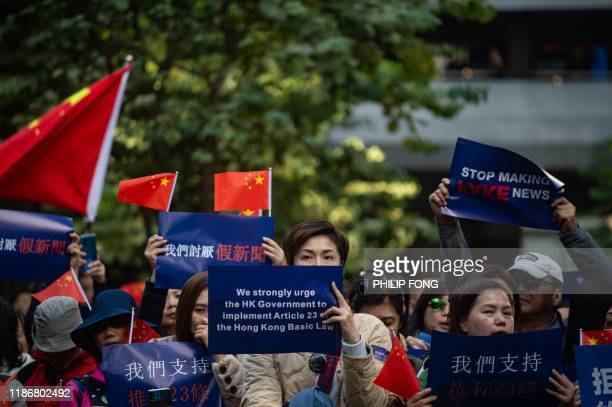 People take part in a proBeijing rally in the Wan Chai district of Hong Kong on December 7 2019 Hong Kong has been battered by six months of often...