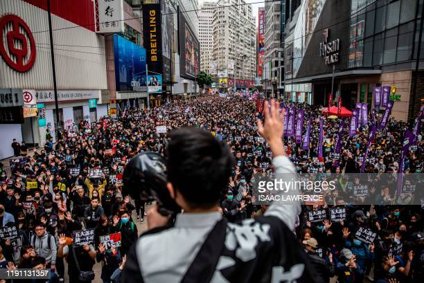 People take part in a pro-democracy march in Hong Kong on January 1, 2020. - Tens of thousands of protesters marched in Hong Kong during a massive...