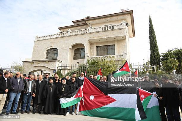 People take part in a protest after the gunmen attacked several police patrols in the southern city of Jordan's Karak in front of the Jordanian...