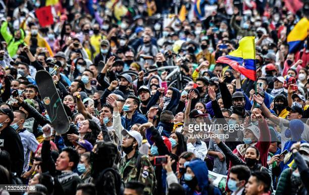 People take part in a protest against a tax reform bill launched by Colombian President Ivan Duque, in Bogota, on April 28, 2021. - Workers' unions,...