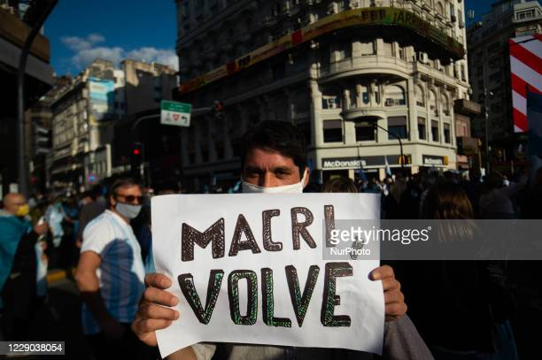 People take part in a protest against the government of Argentina's President Alberto Fernandez, in Buenos Aires, Argentina, on October 12, 2020 amid...