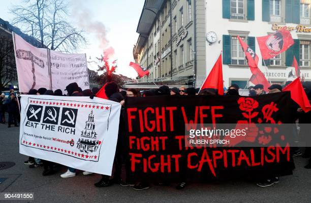 People take part in a protest against the planned visit of the US president to the World Economic Forum in Davos in Bern on January 13 2018 Swiss...