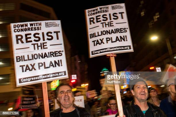 People take part in a protest against the Republican tax bill in Los Angeles California on December 4 2017 Democrats and many economists warn that...