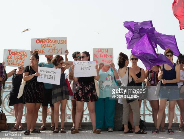 People take part in a protest against the shooting of Woody Allen's new film in the Spanish Basque city of San Sebastian on July 23 2019 The...
