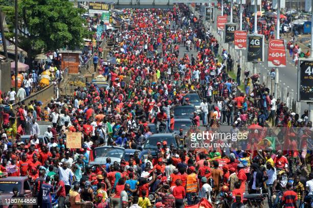 People take part in a protest against the third term of the Guinean President on November 7 2019 in Conakry Crowds of protesters marched through the...