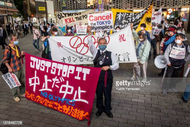 People take part in a protest against the Tokyo Olympics on May 17, 2021 in Tokyo, Japan. With less than 3 months remaining until the Tokyo Olympics,...