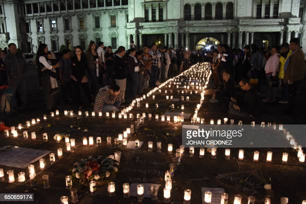 TOPSHOT People take part in a protest at the Square of the Constitution in Guatemala City on March 9 following the death of 34 girls in a recent fire...