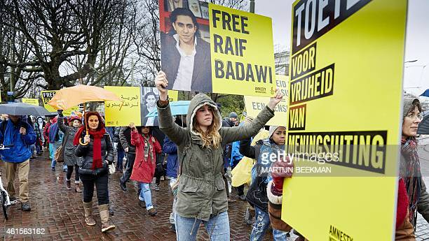 People take part in a protest by Amnesty International for the immediate release of the Saudi blogger Raif Badawi in front of the Saudi Embassy in...