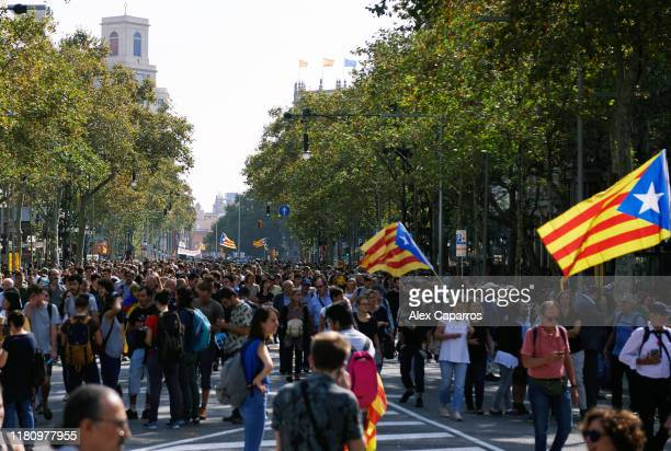 People take part in a protest following the sentencing of nine Catalan separatist leaders on October 14, 2019 in Barcelona, Spain. Spain's Supreme...