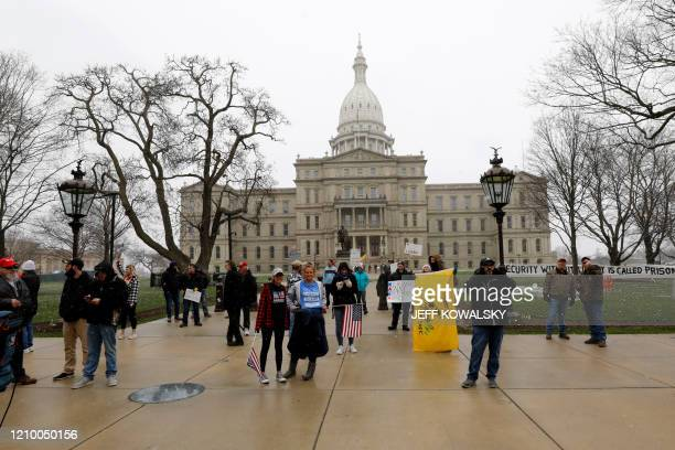 People take part in a protest for Michiganders Against Excessive Quarantine at the Michigan State Capitol in Lansing Michigan on April 15 2020 The...