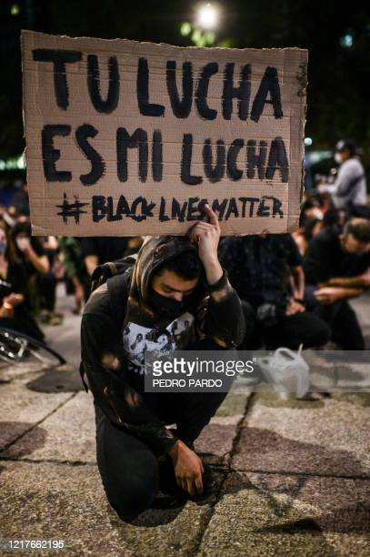 People take part in a protest in front of the US embassy in Mexico City on June 4 over the death of George Floyd in police custody in Minneapolis...