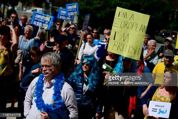 People take part in a protest in Madrid organised by the EuroCitizens group in defence of the rights of Europeans in the UK and Britons in the EU and...