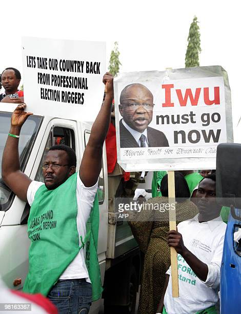 People take part in a protest organized by the Nigerian Labor Congress on March 31 2010 in Abuja calling for the removal of Independent National...