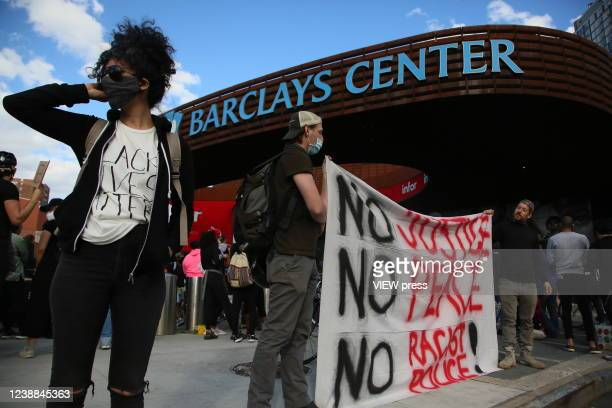 People take part in a protest outside the Barclays Center in Brooklyn on May 31 2020 in New York City Protests spread across the country in various...