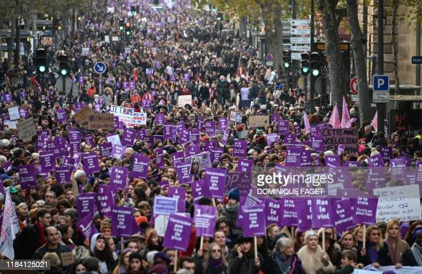 People take part in a protest to condemn violence against women, on November 23 in Paris.