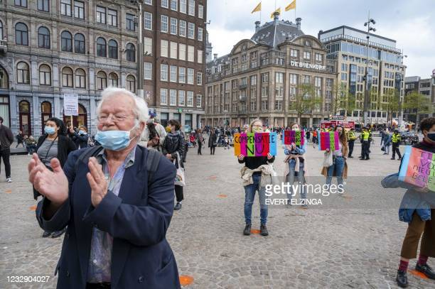 People take part in a protest to denounce a scandal in which tax officials wrongly accused thousands of parents of fraud, on the Damin Amsterdam,on...