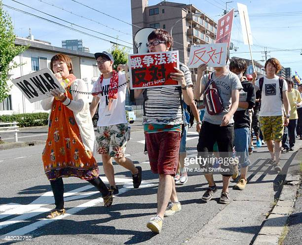 People take part in a rally against antisecurity legislation bills on July 26 2015 in Kusatsu Shiga Japan