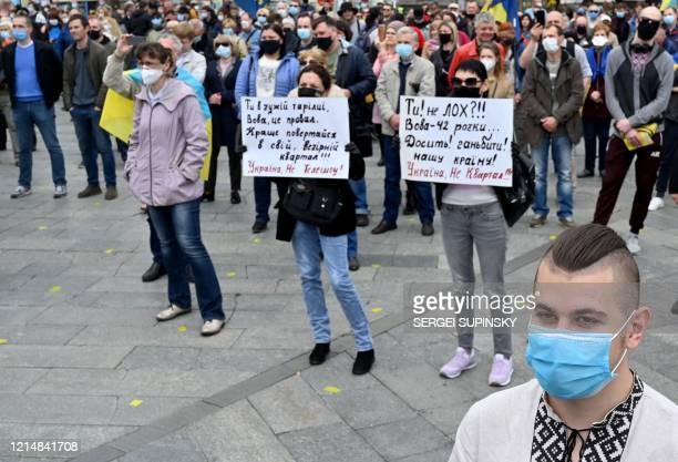 People take part in a rally at Independence Square in Kiev on May 24 2020 called in 30 different cities by Ukrainian farright and nationalist parties...