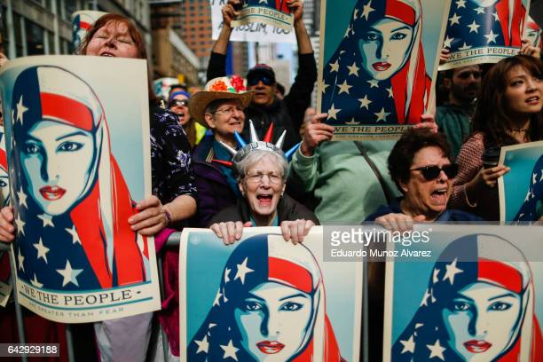 People take part in a rally called 'I Am A Muslim Too' in a show of solidarity with American Muslims at Times Square on February 19 2017 in New York...
