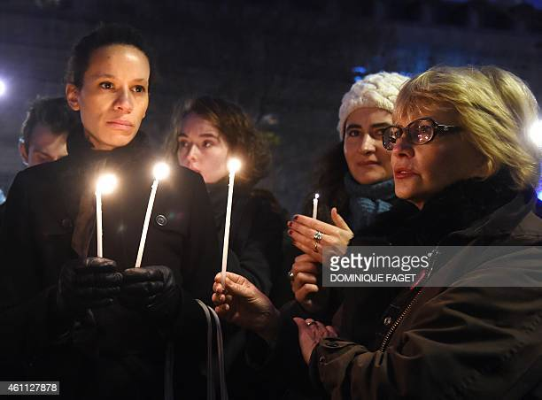 People take part in a rally in support of the victims of today's terrorist attack on French satyrical newspaper Charlie Hebdo at the Place de la...
