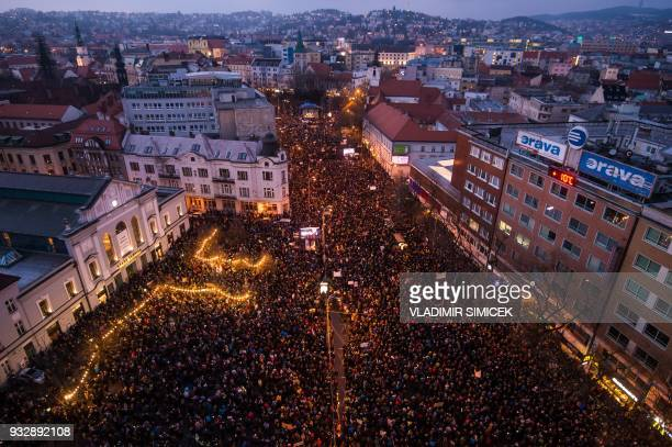 People take part in a rally near the Slovak National Uprising square under the slogan For a Decent Slovakia against corruption and to pay tribute to...