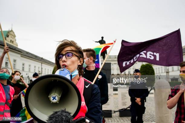 People take part in a rally of the LGBTQ+ community against the Polish president Andrzej Duda and against the amendment to the Polish constitution...