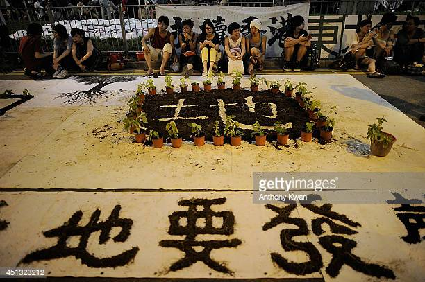 People take part in a rally outside of Legislative Council Building on June 27 2014 in Admiralty Hong Kong Protesters are demanding the Hong Kong...