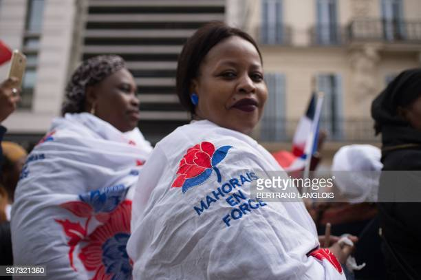 People take part in a rally to protest against insecurity and immigration on the French Indian Ocean island of Mayotte on March 24 2018 / AFP PHOTO /...