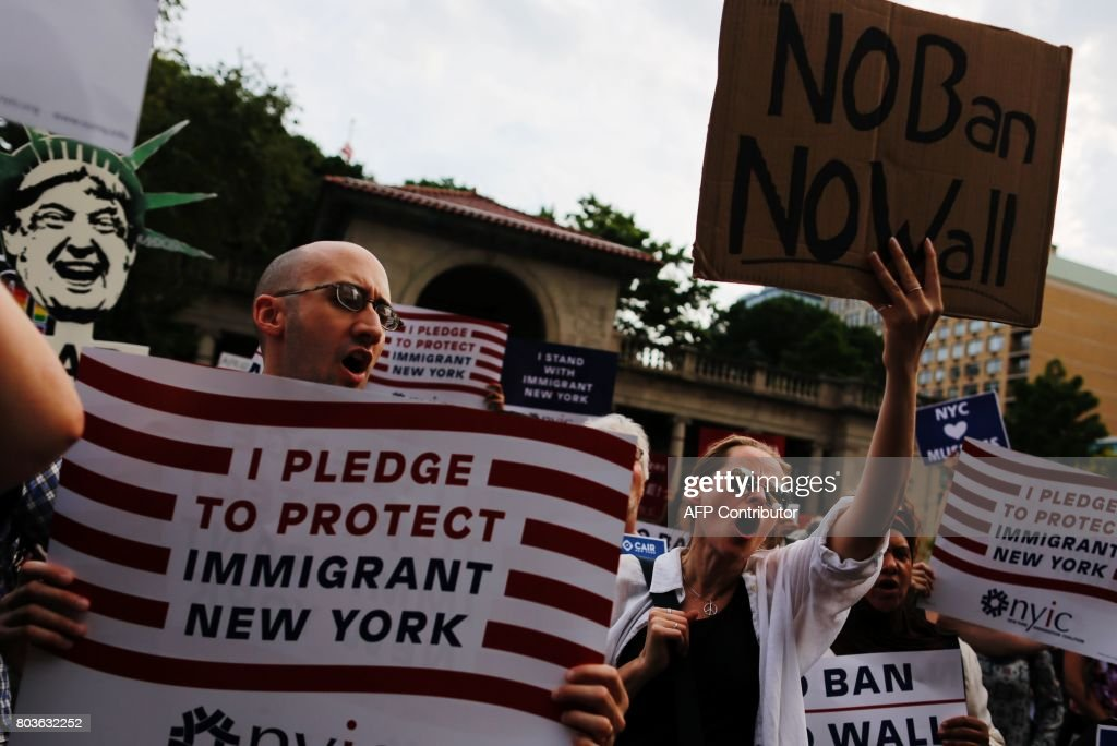 People take part in a rally to protest restrictive guidelines issued by the US on who qualifies as a close familial relationship under the Supreme Court order on the Muslim and refugee ban at Union Square on June 29, 2017, in New York. US President Donald Trump's five-month effort to implement a promised ban on travelers from six mostly Muslim countries and on all refugees takes effect late Thursday, July 29, 2017 as controversy swirls over who qualifies for an exemption based on family ties. ALVAREZ