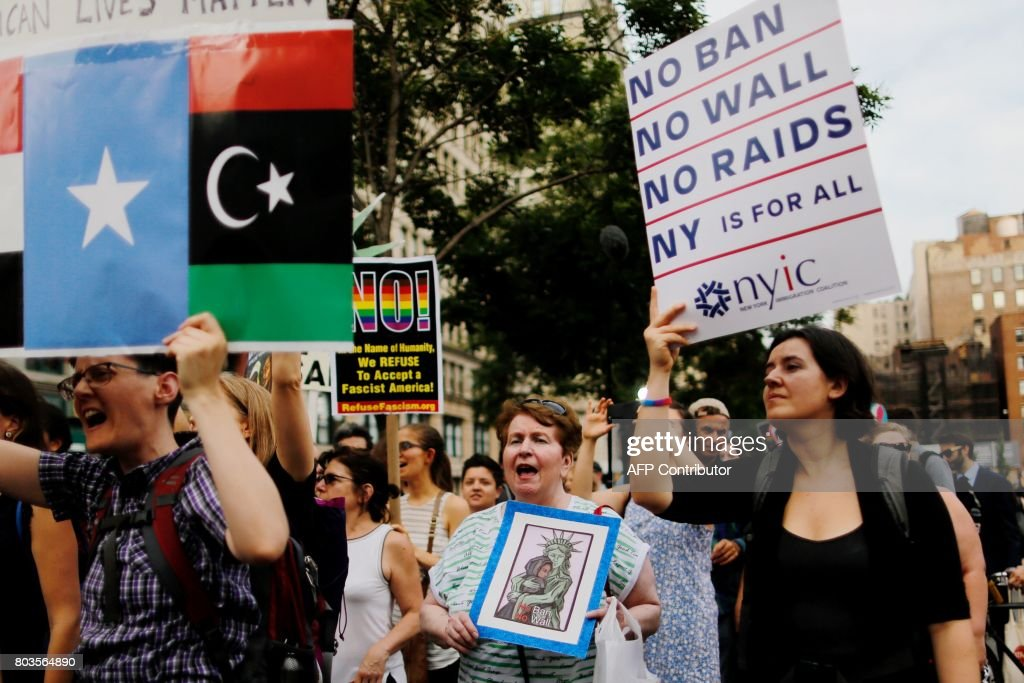 People take part in a rally to protest the restrictive guidelines issued by the US on who qualifies as a close familial relationship under the Supreme Court order on the Muslim and refugee ban at Union Square on June 29, 2017, in New York. US President Donald Trump's five-month effort to implement a promised ban on travelers from six mostly Muslim countries and on all refugees takes effect late Thursday, July 29, 2017 as controversy swirls over who qualifies for an exemption based on family ties. ALVAREZ