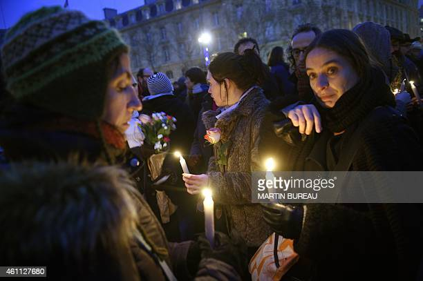 People take part in a rally to show their solidarity with the victims of the today's terrorist attack on French satyrical newspaper Charlie Hebdo at...