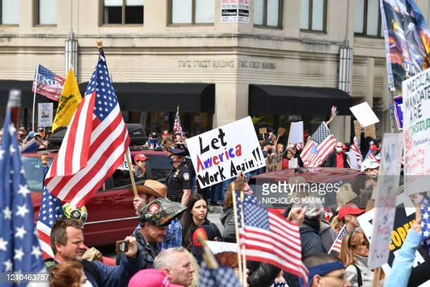 People take part in a reopen Pennsylvania demonstration on April 20 2020 in Harrisburg Pennsylvania Hundreds have protested in cities across America...