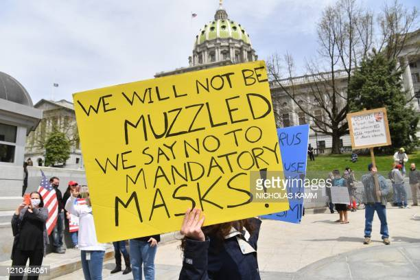"""People take part in a """"reopen"""" Pennsylvania demonstration on April 20, 2020 in Harrisburg, Pennsylvania. - Hundreds have protested in cities across..."""