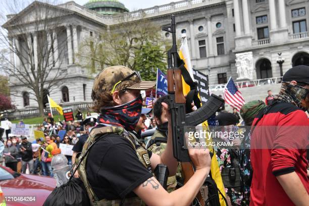 """People take part in a """"reopen"""" Pennsylvania demonstration on April 20, 2020 in Harrisburg, Pennsylvania. - Hundreds of people including lawmakers..."""