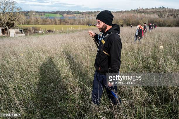 People take part in a search organised by French gendarmes in the woods of Milhars, on December 23 to look for Delphine Jubillar, a woman missing...