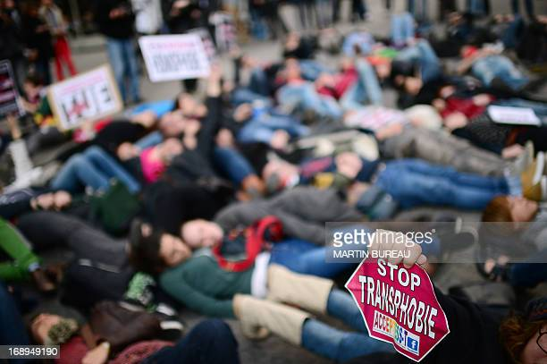 People take part in a sitin protest called by Act Up gay organisation on May 17 2013 in Paris as part of the International Day Against Homophobia and...