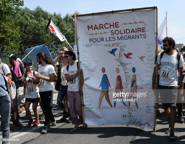 People take part in a 'solidarity' march in support of migrants in Calais on July 7 2018 Several hundred people took part in the march organised by...