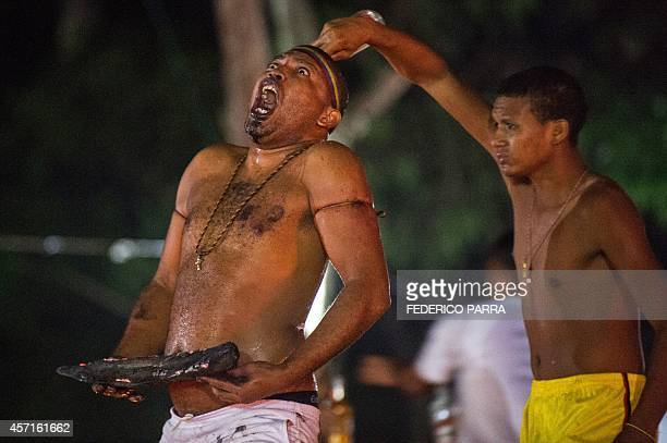 People take part in a spiritual ceremony in the mountains of Sorte in Yaracuy west of Caracas on October 12 2014 Santeria and Spiritualism is a...