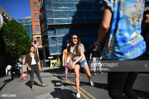 People take part in a street volley ball match by St Ann's Square in central Manchester northwest England on May 26 2017 Thousands of people...