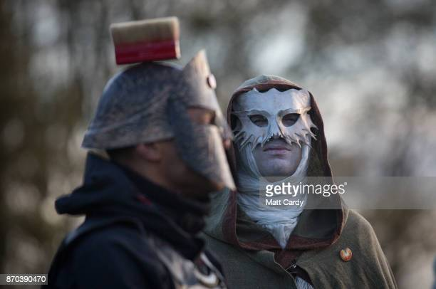 People take part in a sunset ceremony on the lower slopes of Glastonbury Tor as they celebrate Samhain at the Glastonbury Dragons Samhain Wild Hunt...