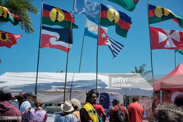 People take part in a symbolic day marking the taking of possession of New Caledonia by France on September 24 1953 organized by 150 Years After...