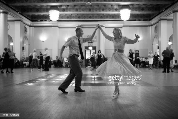 People take part in a tea dance at Sheffield's City hall on August 1 2017 in Sheffield England The popular tea dance session coincides with the...
