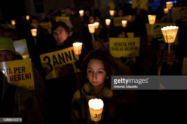 People take part in a torchlight procession organized by Amnesty International to commemorate the killing of death of Giulio Regeni on January 25...