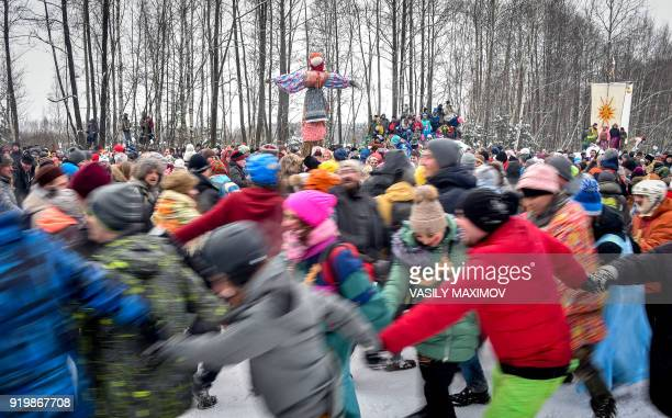 TOPSHOT People take part in a traditional round dance during the festivities of Shrovetide or Maslenitsa close to the village of Electrougli outside...