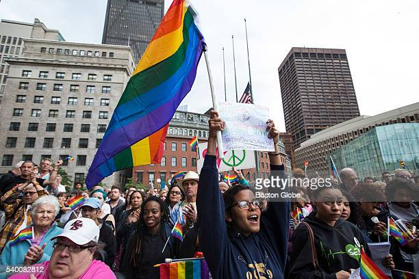 People take part in a vigil for victims of the mass shooting at an Orlando nightclub at City Hall Plaza in Boston on June 13, 2016.