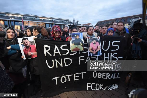 People take part in a vigil in Hanau near Frankfurt am Main western Germany on February 20 after at least nine people were killed in two shootings...