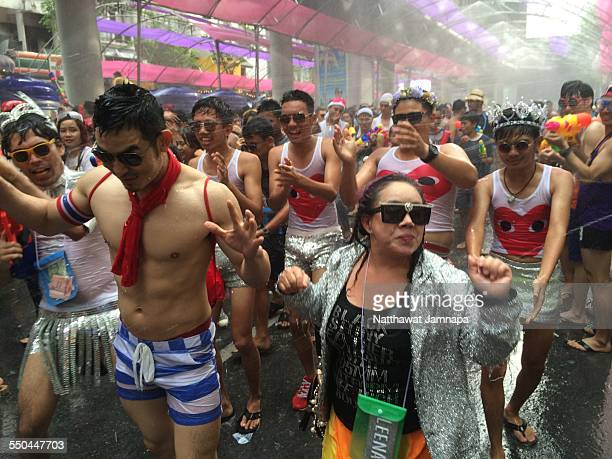 People take part in a water fight during the Songkran water festival in Silom Road in Bangkok. The Songkran Festival runs from 13 to 15 April with...