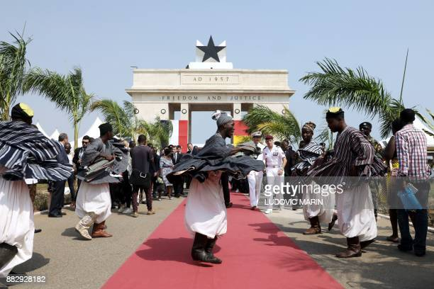 People take part in a welcoming ceremony for France's President at the Independence square upon his arrival in Accra on November 30 2017 / AFP PHOTO...