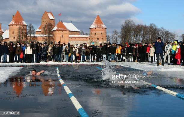 People take part in an annual winter swimming competition in freezing water with temperature outside dropping to minus 12 degrees Celsius on February...
